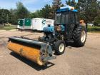 New Holland 4630 Turbo Tractor with Sweepster Attachment