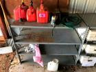 4 Tier Metal Shelving Unit with 3 Fuel Cans, Hedge Trimmer, Electrical Cord