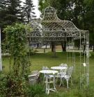 Wrought Iron Gazebo with Chairs and Tables