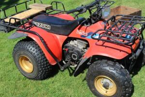 Suzuki 250 quad with 2455 miles 76 hours