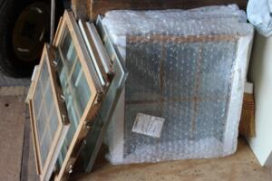 Assorted thermal pane replacement windows with 6 section grid