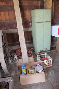 Box of assorted paint tools, misc. electric cords, new cloths line poles, green cabinet and more