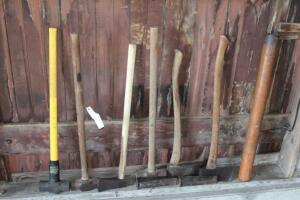 Assorted mauls, sledge hammers, and wedges