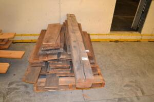 Pallet of barn wood with a beam