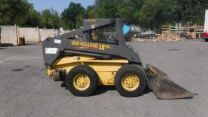 NEW HOLLAND LS180 SKID STEER WITH JOYSTICK CONTROLS, 2 SPEED TRANSMISSION