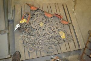 pallet of chains and rigging hooks
