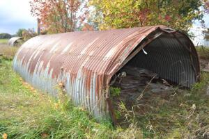 Quonset hut with lumber and contents