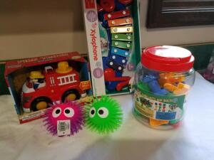 Toys: Xylophone, Fire Truck, Jumbo Nuts/Bolts, 2 Puffer Balls- Donated by Friend of Optimist