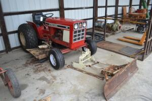International 184 tractor with mower and blade