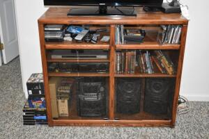 Entertainment Center with Contents- Panasonic Stereo, DVD Player, VHS Player, Etc.