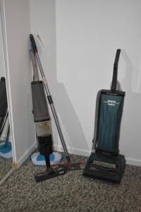 Vacuums and Spin Broom