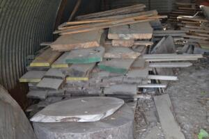 Oak lumber and contents of Quonset hut