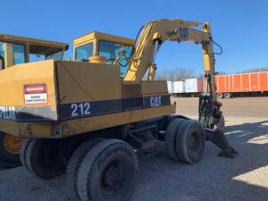 Cat 212 Wheeled excavator showing 2284 hours