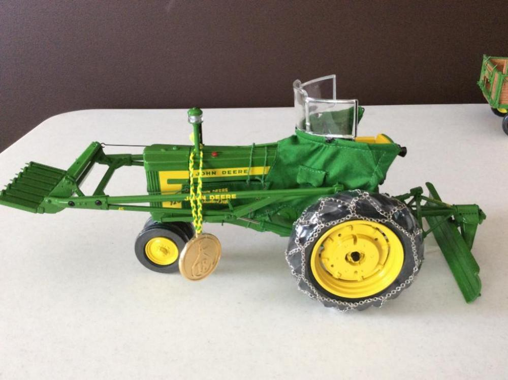 Precision John Deere 720 Tractor with 80 Blade and 25 Loader