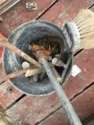Bucket of Masonary Tools and pipe clamp